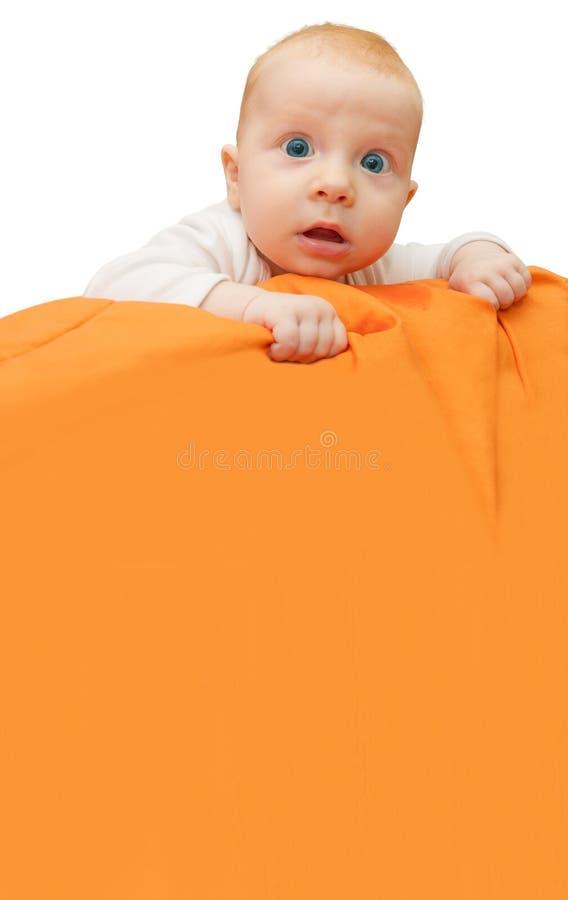 Bebê que guardara o sinal imagem de stock