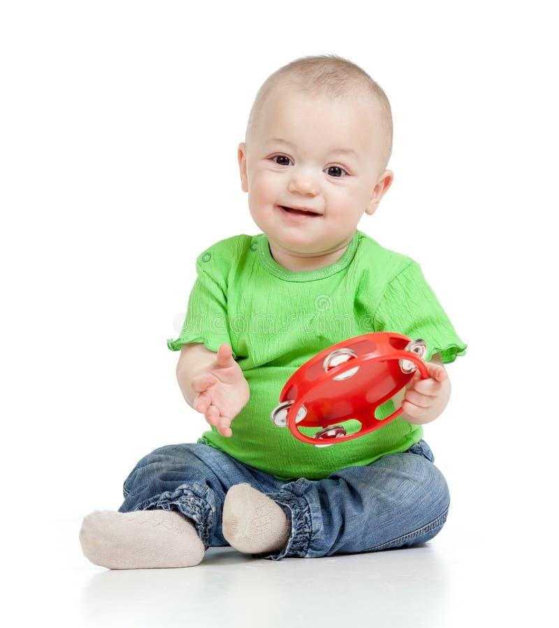 Bebê que joga com brinquedo musical fotografia de stock