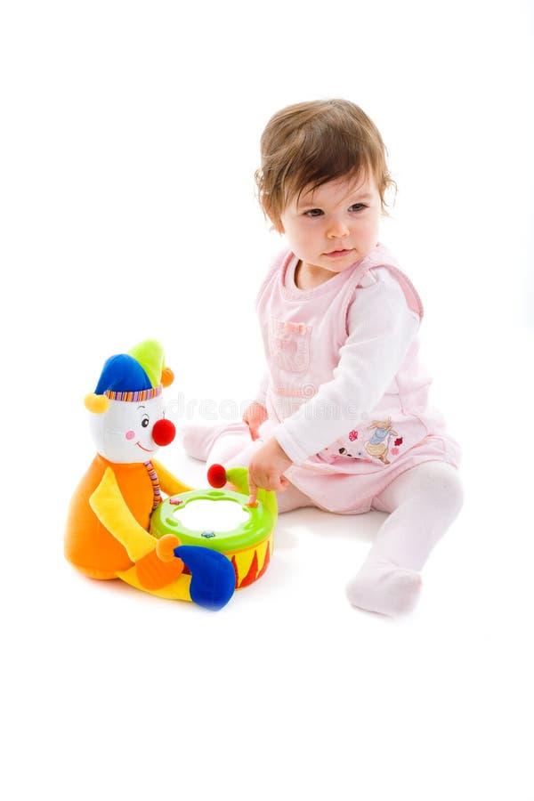 Bebê que joga o entalhe fotos de stock
