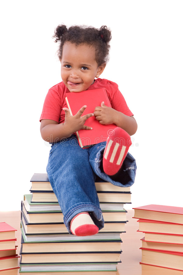 Bebê que senta-se em uma pilha dos livros fotografia de stock royalty free