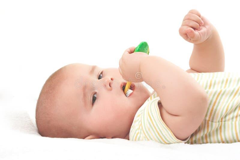 Bebê que toothbrooshing foto de stock royalty free