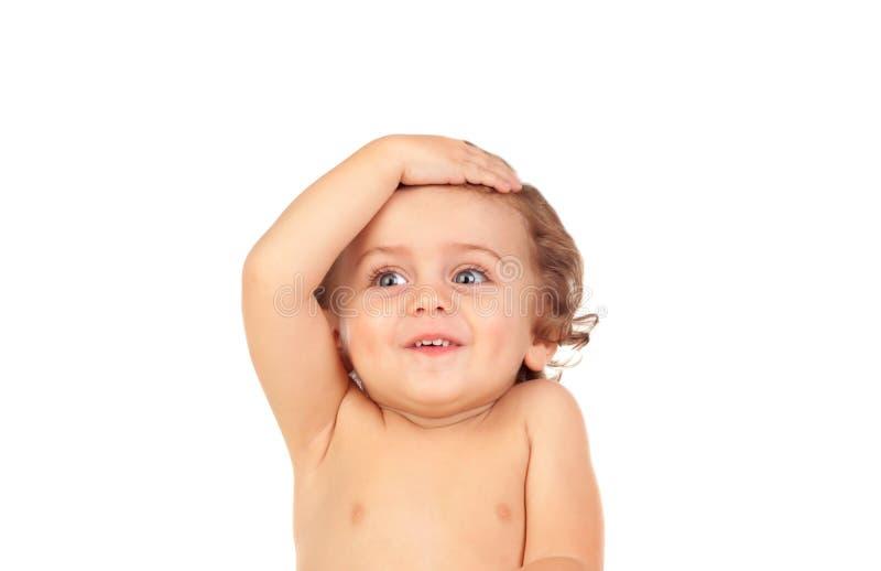 Bebê surpreendido com olhos azuis imagem de stock royalty free