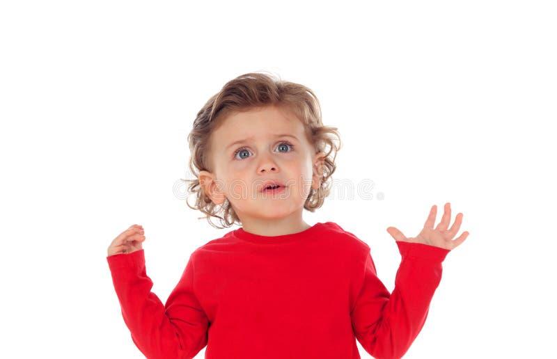 Bebê surpreendido com suas mãos levantadas imagens de stock