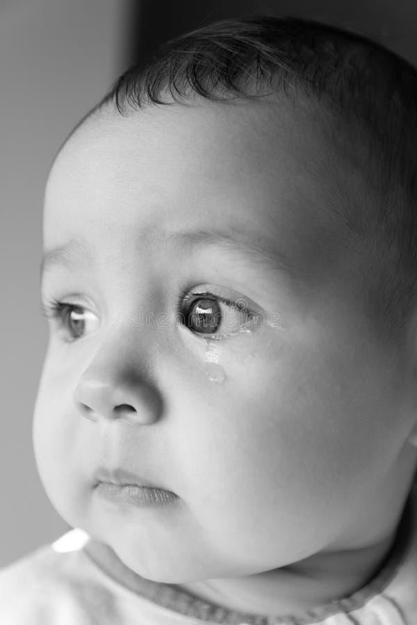 Bebê triste da cara Um rasgo na cara fotos de stock