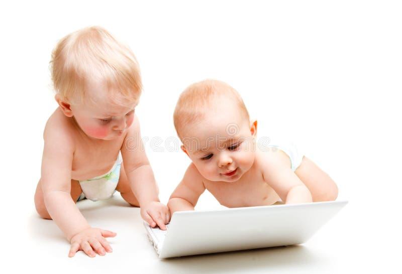 Bebês do computador imagens de stock royalty free