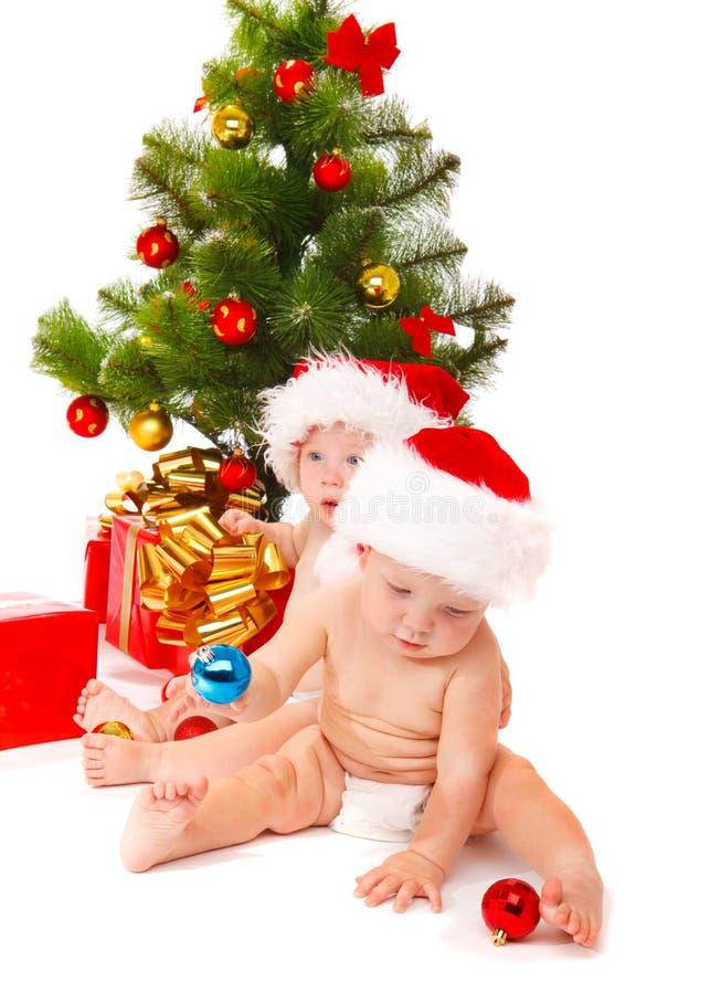 Bebês em chapéus vermelhos imagem de stock