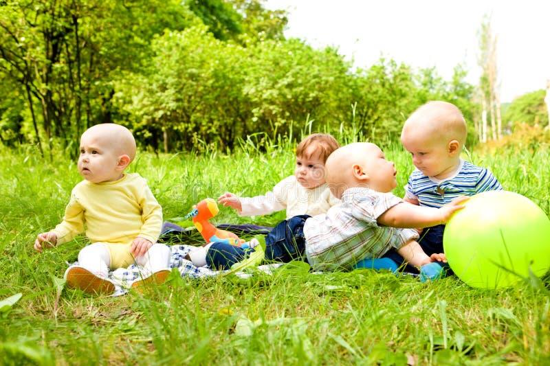 Bebês no ao ar livre fotografia de stock royalty free