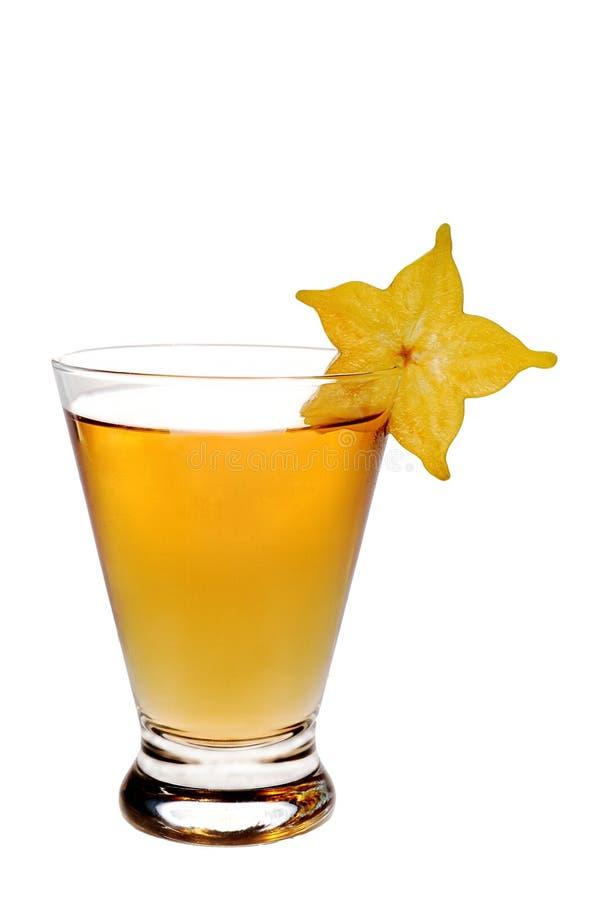 Bebida anaranjada con el starfruit foto de archivo