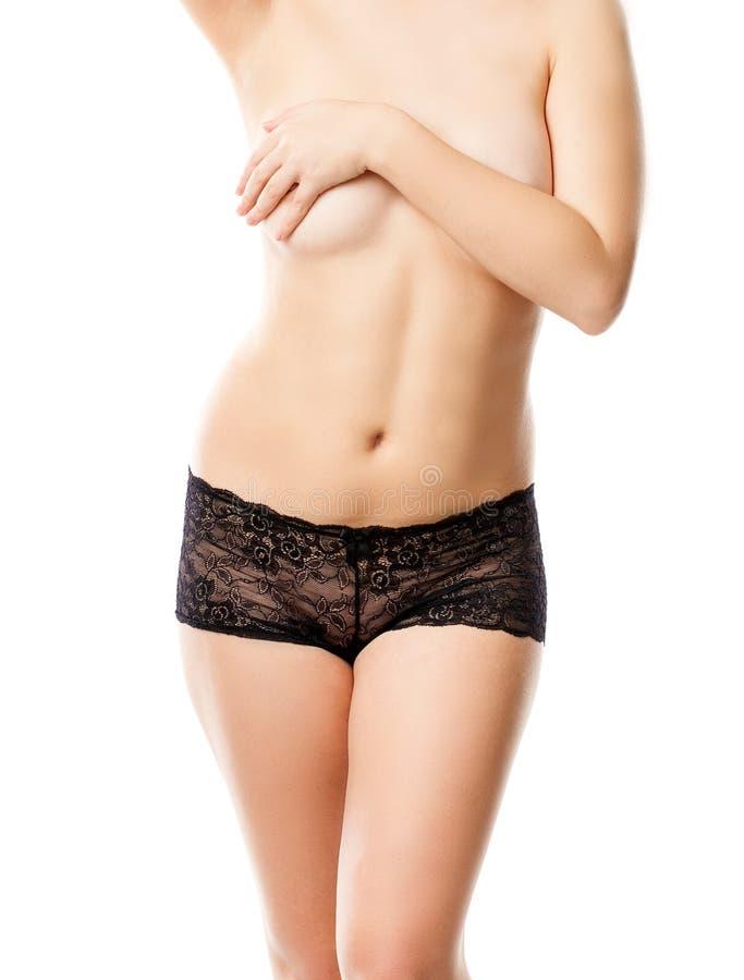 Bebouwde foto van de borst van een jonge vrouw stock afbeelding