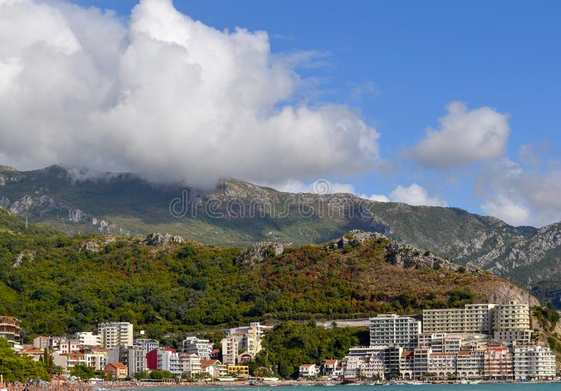 Coastal city at the foot of the mountain. Becici, Montenegro, View of the city and mountains royalty free stock photos
