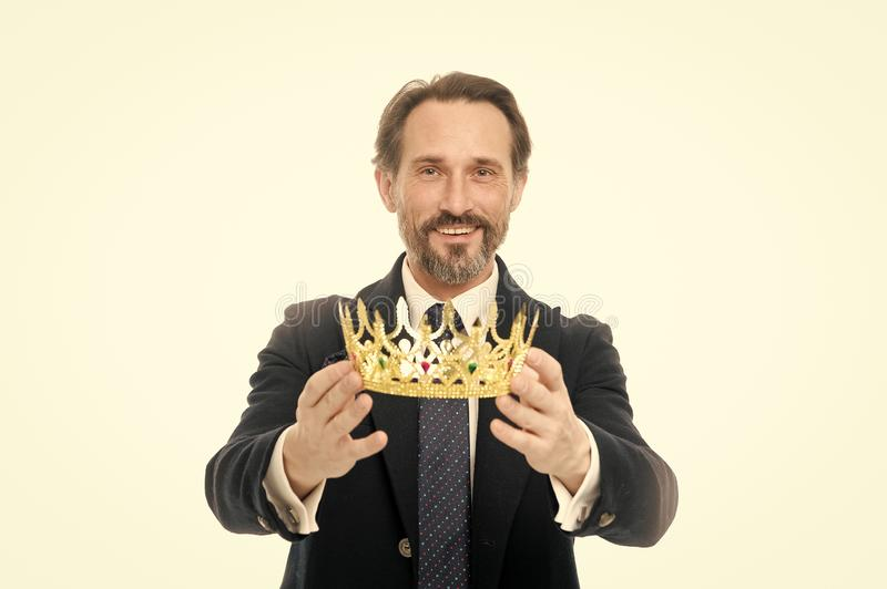 Become king ceremony. King attribute. Become next king. Monarchy family traditions. Man nature bearded guy in suit hold. Golden crown symbol of monarchy. Direct royalty free stock photo