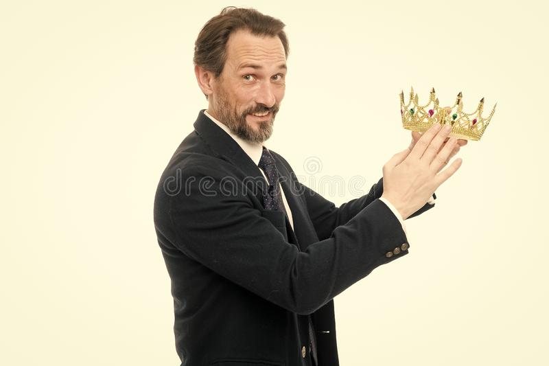 Become next king. Monarchy family traditions. King attribute. Man nature bearded guy in suit hold golden crown symbol of stock photography
