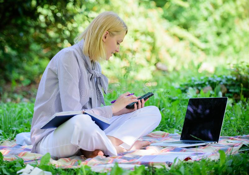 Become successful freelancer. Managing business outdoors. Woman with laptop sit grass meadow. Business lady freelance stock photo