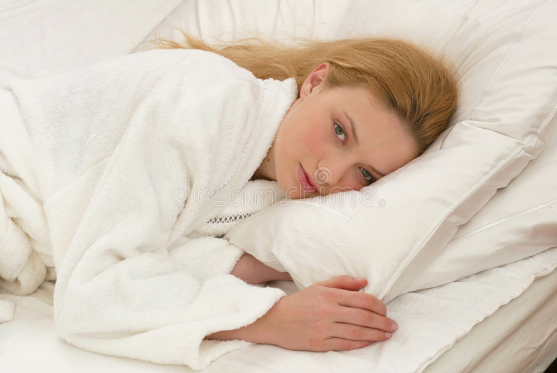 In bed royalty-vrije stock foto
