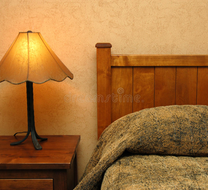 Bed. A bed and night lamp royalty free stock photos