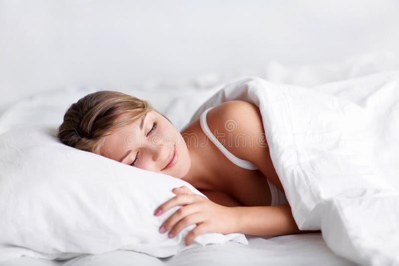 In bed stock afbeeldingen