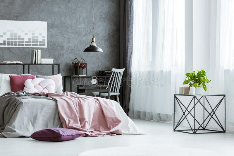 Bed against concrete wall royalty free stock photos
