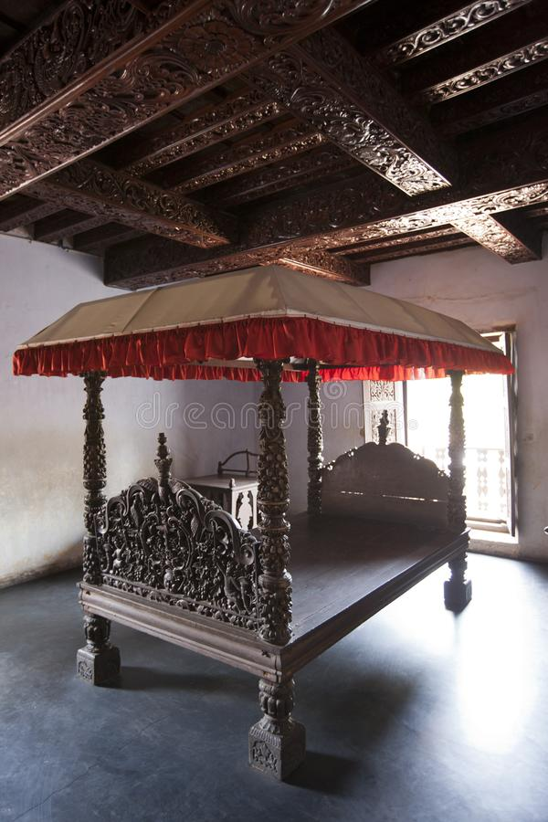 Bed in  ancient wooden palace Padmanabhapuram of the maharaja in Trivandrum, India.  royalty free stock photos