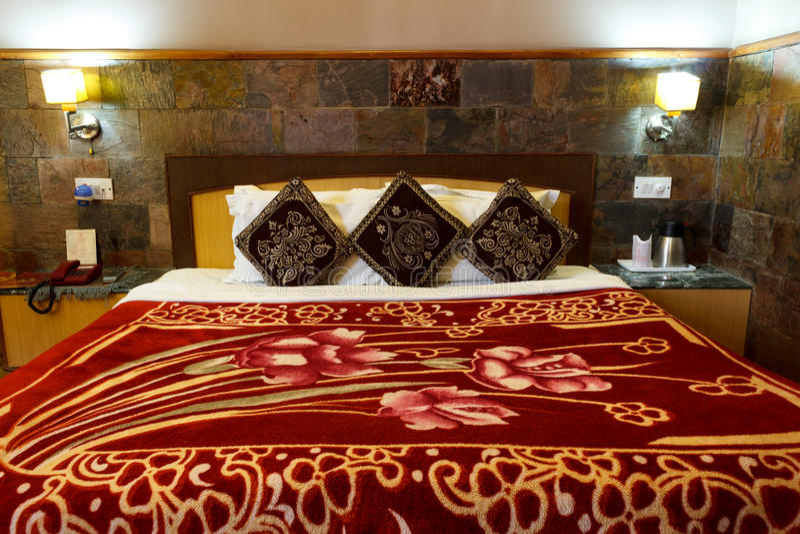 Bed in bedroom, home interior design stock photos