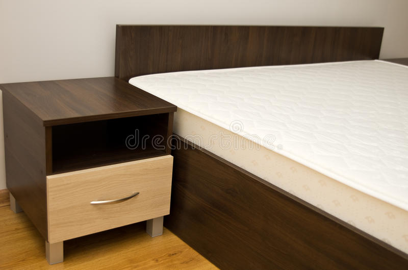 Bed and bedside table stock photography