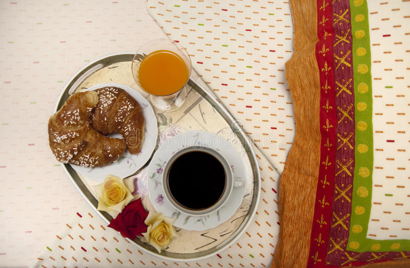 Bed breakfast. Tray with breakfast on a bed royalty free stock images