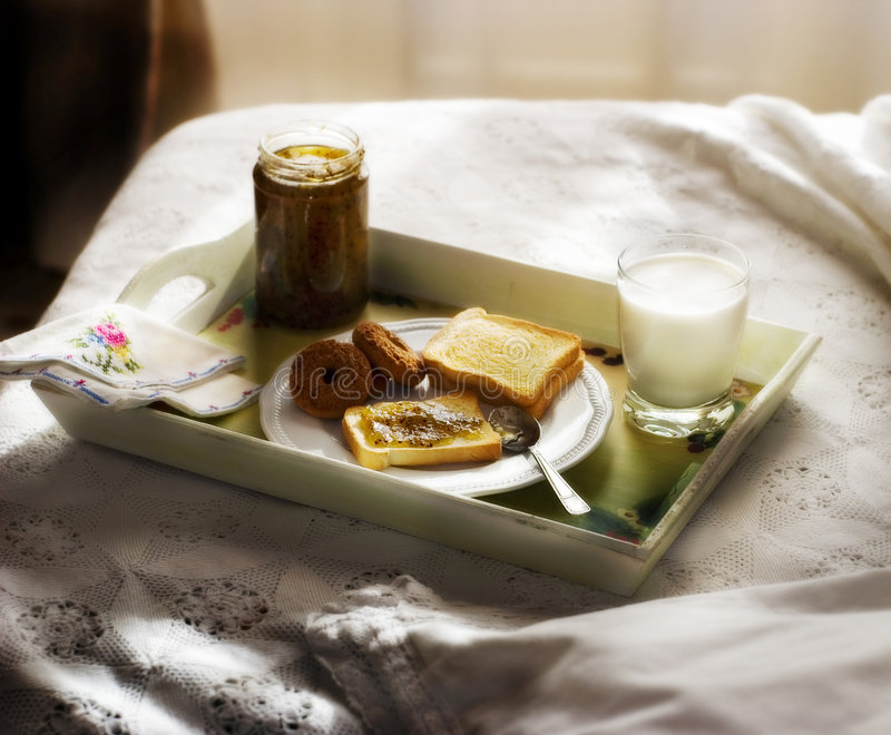 Bed & breakfast 3. Breakfast served in bed, on the tray bread. biscuits, jam and milk stock images