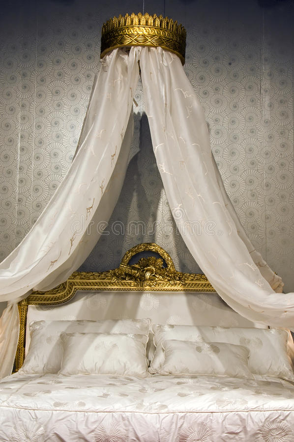 Bed with a canopy stock images