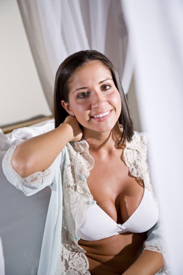bed canopy hispanic sitting white woman young στοκ εικόνες
