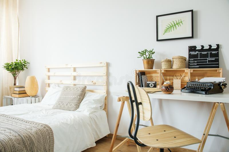 Bed and desk in room royalty free stock images