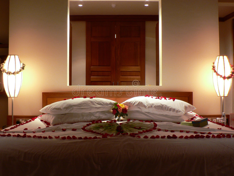 Bed with flowers royalty free stock photo