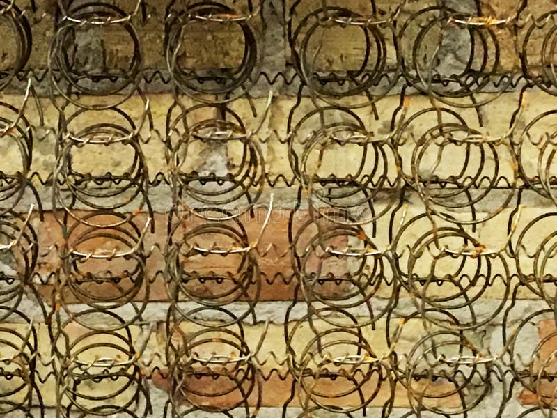 Bed Frame Springs Old. Old Coil Springs Bed Frame against a Brick Wall. Great Background antique stock images