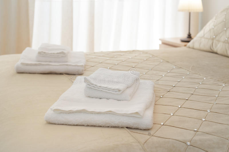 Bed with fresh towels. Bed with fresh and clean towels royalty free stock photography