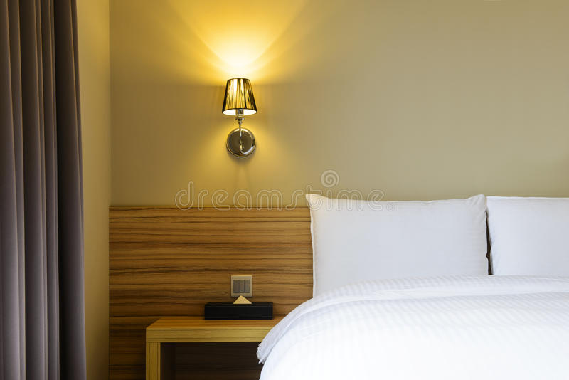 Bed in hotel room stock images
