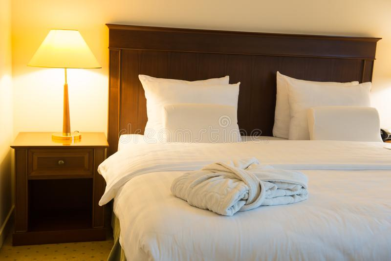 The bed in the hotel room royalty free stock photography
