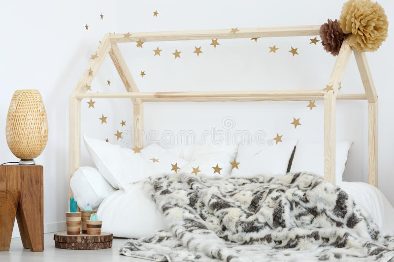 Bed in kid`s room stock photo