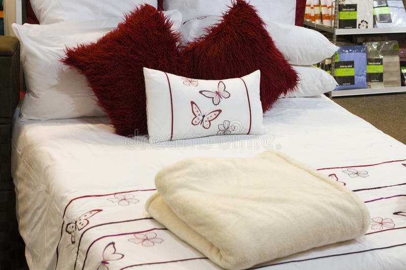 Bed with linen in a house accessory retail store royalty free stock images