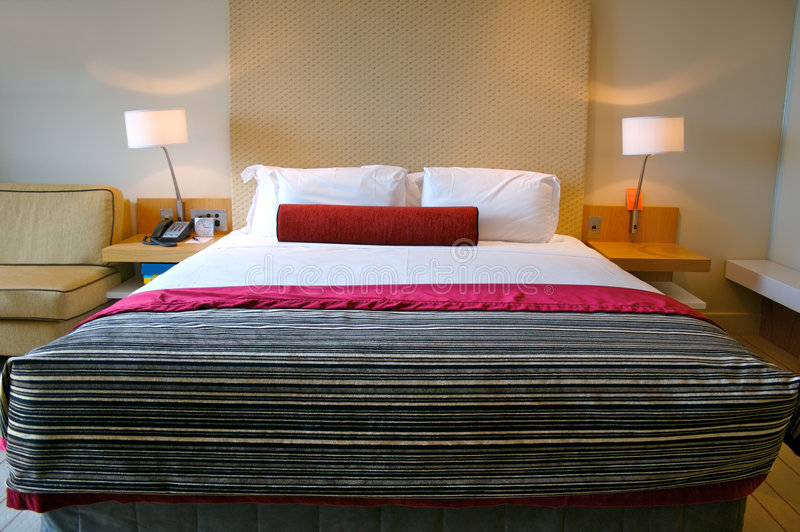 Bed in a luxury hotel room stock photos