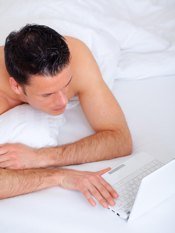 Download Bed Lying Person With Computer Stock Photo - Image: 13176722