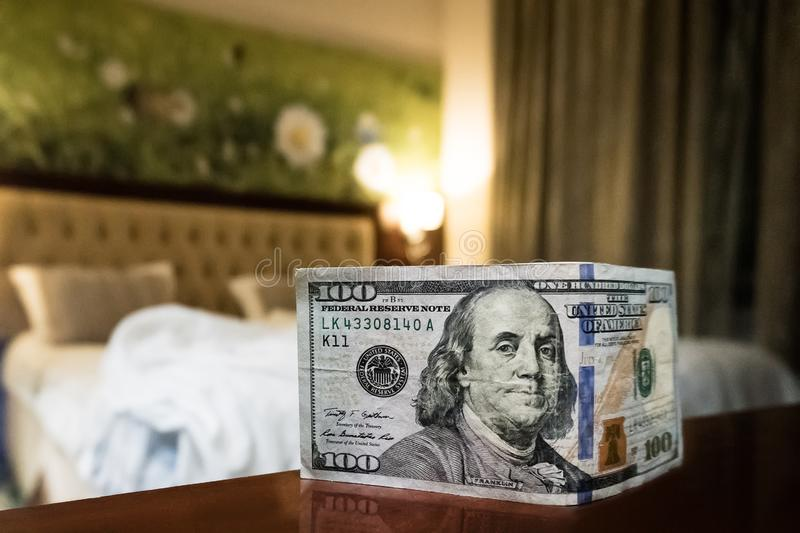 bed and money to symbolize the cost of sex. royalty free stock photography