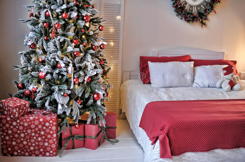 Bed next to the Christmas tree stock image