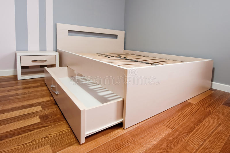 Bed with open drawer royalty free stock image