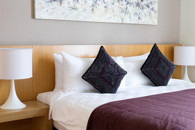 Bed with pillows. And brown blanket royalty free stock photos