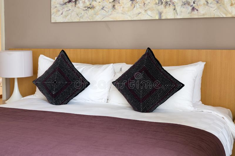 Bed with pillows. And a crimson blanket stock photo