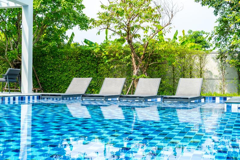Bed pool with outdoor swimming pool in hotel and resort. For travel and vacation stock photo