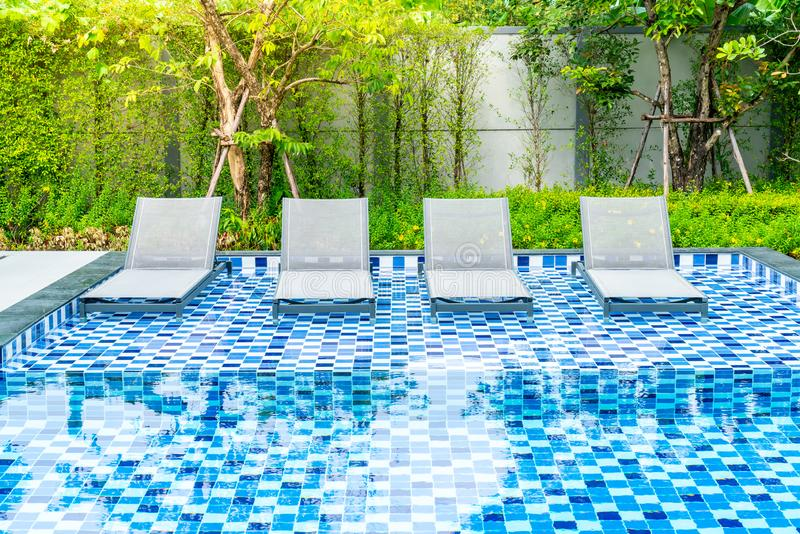 Bed pool with outdoor swimming pool in hotel and resort. For travel and vacation royalty free stock image