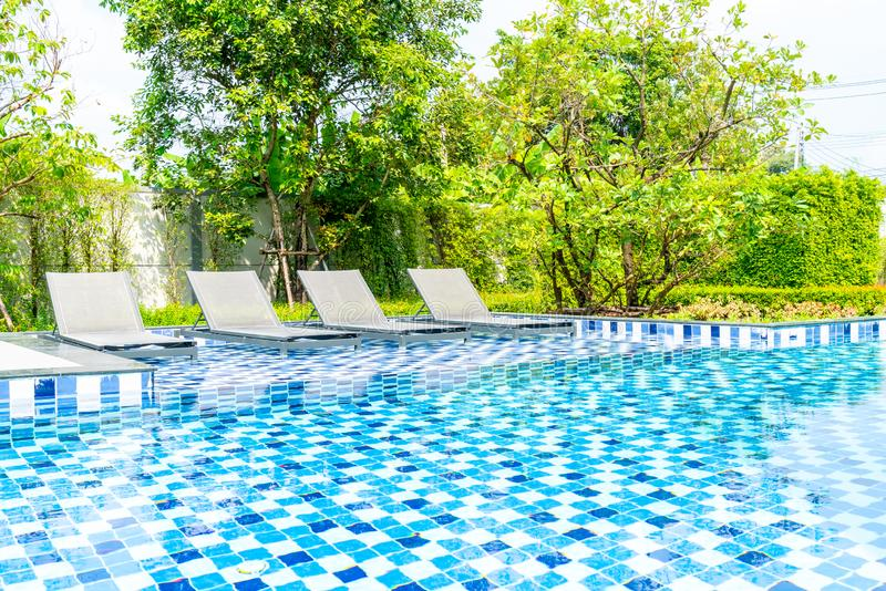 Bed pool with outdoor swimming pool in hotel and resort. For travel and vacation stock image