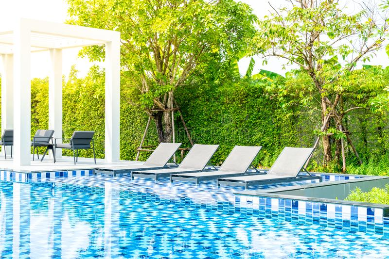 Bed pool with outdoor swimming pool in hotel and resort. For travel and vacation stock photography