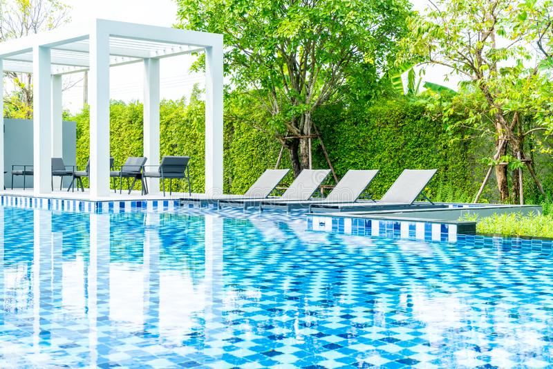 Bed pool with outdoor swimming pool in hotel and resort. For travel and vacation royalty free stock photo