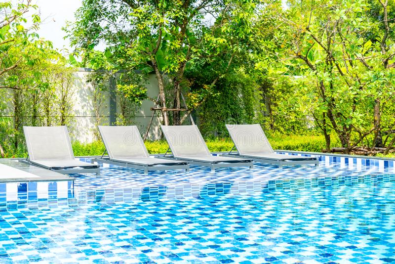 Bed pool with outdoor swimming pool in hotel and resort. For travel and vacation royalty free stock images