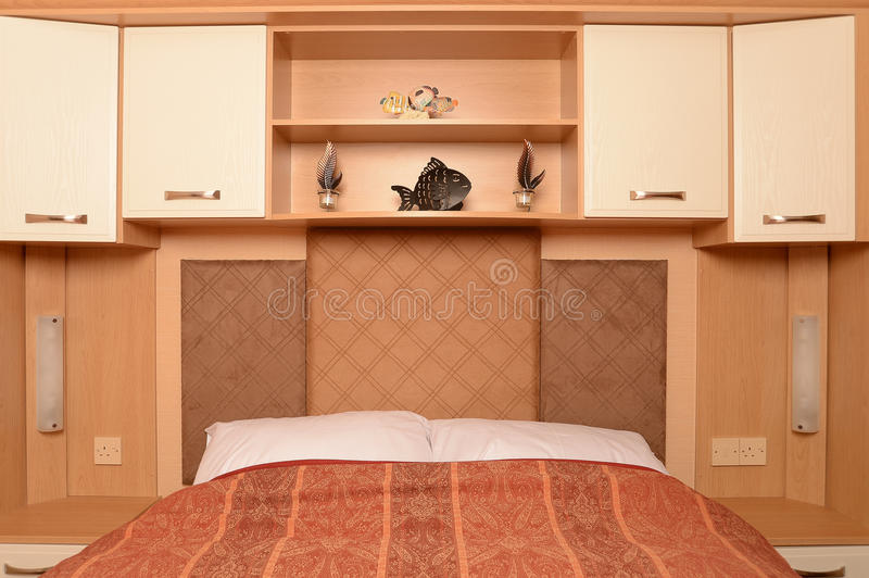 Bed with shelves and cabinets
